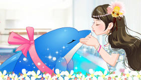 Bisous entre une fille et son dauphin